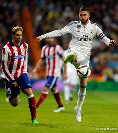 Sergio Ramos of Real Madrid in action against Fernando Torres of Atlético de Madrid during the Copa del Rey round of 16 second leg match between Real Madrid and Atletico de Madrid at Estadio Santiago Bernabeu on January 15, 2015 in Madrid, Spain.