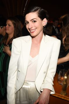 A chic take on the women's tux: Anne Hathaway in an ivory dinner jacket and hammered-satin trousers at the 2015 Met Gala after-party.