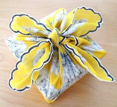 """This would be great, buy an inexpensive scarf for wrapping """"paper"""" for my homemade note cards! What a fun and inexpensive present!"""