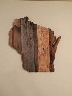 This piece of art was created in my shop using all reclaimed wood. It contains elements from an old pallet, a torn down shed, and some rough sawed