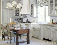 Louis XV-style dining chairs and the patterned blind makes this a beautiful kitchen, but because I have kids, the chairs would be stained within a month. However, the window covering I could definately do - such a fun pattern for a kitchen