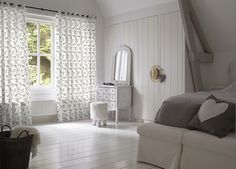 Printed draperies in light cotton bring the outside in.