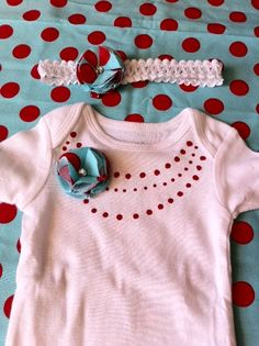 embellished onesie and headband...fabric paint on the back of a paint brush and fabric flowers make a plan white onesie & headband much cuter