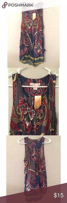 Printed Sleeveless Tunic NWT Sleeveless Tunic. Super cute layered under a sweater with the print peeking out the bottom. Note the pockets and buttons that run down the front Francesca's Collections Tops Tunics