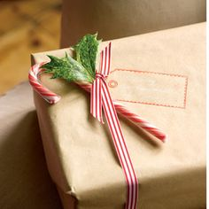 Stamp a name tag & tuck a holly sprig & candy cane under the bow for simple, festive elegance