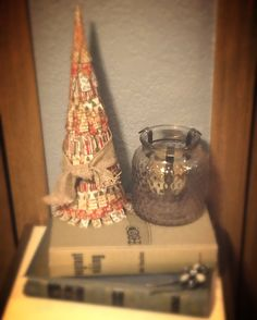 Mini cone tree made from scrapbook paper, old book pages, and burlap ribbon. Super easy, just use Mod Podge!