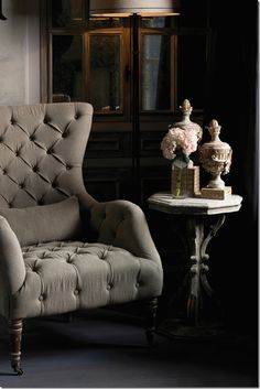 tufted grey wingback chair vignette