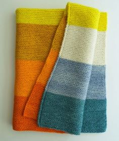 Every day at Purlat leastone customer comes in looking for a really easy baby blanket pattern. It's such a basic request, and, yet, my co-workers and I have a hard time offering a basic solution. The reason is that not many knit designers bother to make patterns for simple rectangles or squares, assuming that, because it would be so easy for them to figure out, it must be easy for everyone else to figure out too! I designed this blanket usingAlchemy's new yarn, Templea super-wash,...