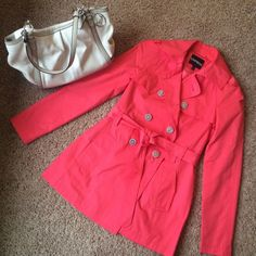 Coral Express trench jacket- perfect for Spring **not yet for sale**  excellent condition coral trench jacket from Express. Gorgeous color and lightweight, perfect for spring and cold summer nights. Wide notched collar, slant hand pockets, lined, double breasted front with storm flaps. Cotton/polyester. Belt at waist, buttons up the front. Express Jackets & Coats