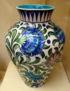 A William De Morgan- vase  William Frend De Morgan  was of French Huguenot Extraction  (16 November 1839 – 15 January 1917) was an English potter and tile designer.[1] A lifelong friend of William Morris, he designed tiles, stained glass and furniture for Morris & Co. from 1863 to 1872