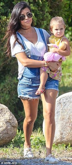 My mini me: Kourtney's precious daughter was dressed ion a floral pink and yellow frock wi... Photo: Wagner Az