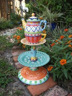 Garden Teapot Totem. DIY you can use clay pieces or steel, paint as you like, find something for top focal item.