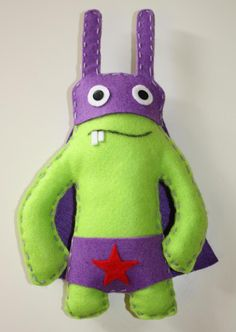 Doudou, Petit monstre/lapin en feutrine Super héros est une création orginale de Pouic_Pouic sur DaWanda