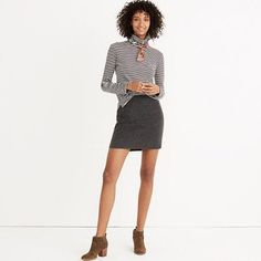A shape we return to year after year, this is our favorite curved-hem update to a traditional wool-blend mini skirt. Dress it up (high boots), dress it down (low boots)—this is one you'll wear again and again. <ul><li>Short, straight skirt.</li><li>Viscose/wool.</li><li>Dry clean.</li><li>Import.</li></ul>