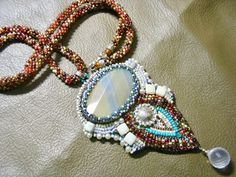 Bead Embroidery Pendant made with Cream Agate and Japanese glass beads. Hanging with Beautiful Rose Quartz drop. *This good for gift, will be great for you or your special person. The pendant measures 2.2x4 inch The length of the necklace is 23 inch (without the pendant).