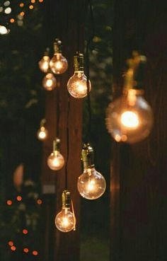 Hanging lights, fairy lights, lanterns and anything else I can think of on trees and the back deck would be a great idea to improve the atmosphere.