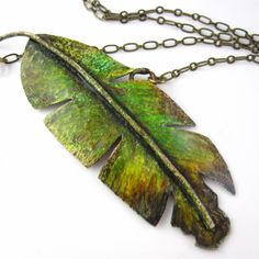Banana Leaf Necklace  Prismacolor on Copper by JifferD on Etsy, $42.00-Here's another feather pendant!