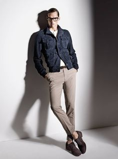 Shop this look on Lookastic:  http://lookastic.com/men/looks/brown-brogues-and-grey-dress-pants-and-navy-military-jacket-and-white-crew-neck-t-shirt/387  — Brown Suede Brogues  — Grey Dress Pants  — Navy Military Jacket  — White Crew-neck T-shirt