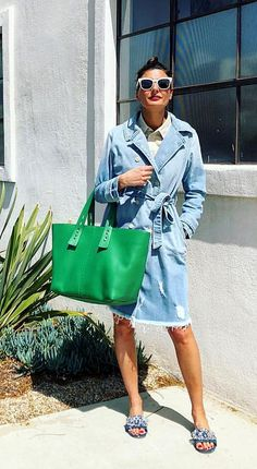Giovanna Battaglia style. Giovanna wearing a denim long sleeve coat/dress and a green bag.