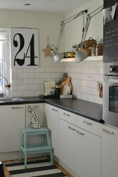 white with black counter, tiles and tall open shelf