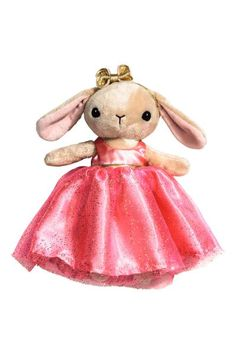 Soft toy: Rabbit soft toy in velour with embroidered details, sewn-on ears and a decorative bow. Detachable dress in satin and glittery tulle with a hook and loop fastening at the back. Polyester padding. Length approx. 24 cm.