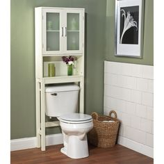Place this white bathroom space saver around the toilet and add bathroom storage space quickly and easily. Features an adjustable shelf in a cabinet and an open shelf for easy access storage. Overall dimensions are 22.5 wide x 7.25 long by 67.3 high.