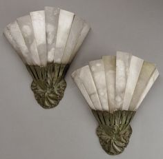"""ALBERT CHEURET """"Algues"""", a pair of wall lamps with a bronze fixture plate holding eight alabaster plates forming reflectors. Signed """"Albert Cheuret"""". Circa 1930. H : 15 ¾"""