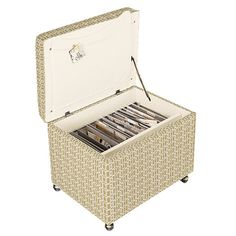 File Storage Ottoman: Its metal frame supports your letter-sized files, while an interior pocket holds a portable work-surface. Plus, there's space to store office supplies. It rolls on antiqued brass casters.