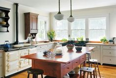 A soapstone sink and a central worktable lend authenticity to a farmhouse kitchen. (Photo: Eric Roth)