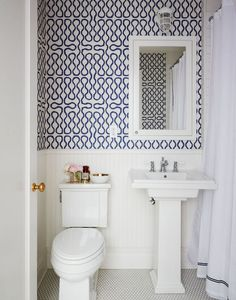 Pattern bursts forth in a powder room covered in Vivienne Westwood for Cole & Son wallpaper.