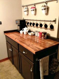 What if I combined a coffee bar with more storage of other items and put it on the desk in the kitchen?