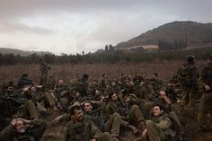 Credit: Chris Hondros/Getty Images Exhausted Israeli soldiers gather after a day's marching on the Israeli-Lebanese border