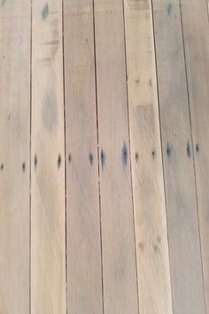 This is what happens when water leaks onto timber floors over time - Rust stains from nails bleed into the timber. Find out more here: http://www.economyfloorsanding.com.au/brisbane-floor-sanding/aspley-floor-sanding-polishing/
