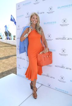 ralphlauren:  The Soft Ricky Bag  American supermodel Christie Brinkley masters monochromatic style in a Black Label one-shoulder dress and matching Soft Ricky bag in Clementine