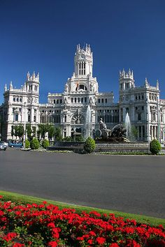 The Plaza de Cibeles is a plaza with marble sculptures and fountains of iconic symbols representing the city of Madrid, Spain.