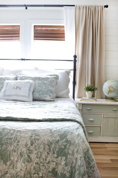 LOVE this from the Lettered Cottage.  Bright and sunny by day with room-darkening shades for those 4am NW sunsets.  Curtains are around 25 bucks a pair from Ikea, bedding is Pottery Barn matine toile, PB Knock off headboard Kensington from JC Penney- $149 queen size.