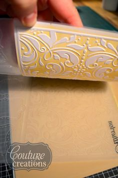 How to use your embossing folders to make a letterpress background for your layouts.