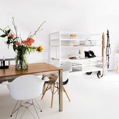 Sometimes even a splendid flower display in cinnamon brights is enough to give a space a boost. It certainly works in this otherwise all-white apartment.