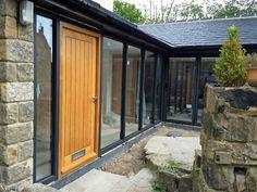 Pushing the design boundaries at Marlin - a handmade oak entrance door incorporated into an aluminium glazing system.