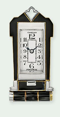 AN ART DECO ENAMEL LAPEL WATCH, BY CARTIER  The cream-coloured rectangular dial with Arabic numerals and blued steel hands to the plain bezel and black enamel case, with hinged clip and mechanical backwind movement, circa 1935, 4.1 cm high, with French assay marks for platinum and gold Dial and movement signed Cartier, No. 25077