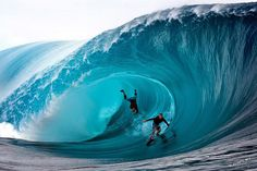 French Polynesia,Tahiti Island, Teahupoo Surfers McNamara and Healey of the U. compete during a free session of surf tow in, in the southern Pacific ocean island of Tahiti.