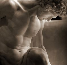"""""""Gladiateur mourant"""", marble (1779) by Pierre Julien (1731-1804). French Rococo and Neoclassical sculptor. Louvre."""