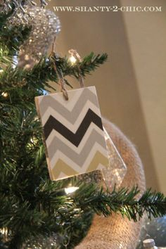 Although this chevron ornament is made out of fabric and wood, this would be way cute with vinyl and wood!