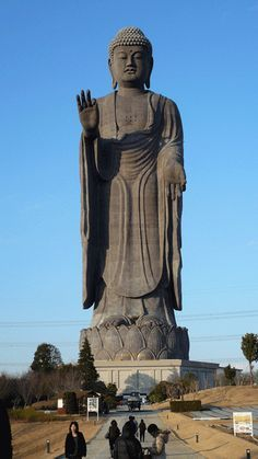 """""""Ushiku Daibutsu"""" - Japan - 120 mtr. high. It looks like a stone statue from a distance but it's actually bronze. There's a lift that takes you 80+ metres up to a viewing platform, there's also a four floor museum inside the beast. Ushiku represents an Amitabha Buddha and was erected to commemorate the birth of Shinran, founder of the """"True Pure Land School"""" of Buddhism."""