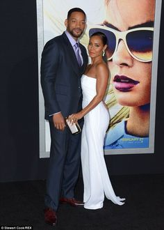 Looking fresh: The 46-year-old wore a dashing three piece suit with a Windsor knot and win...