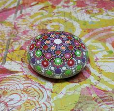 "Mandala Stone (Junior) by Kimberly Vallee: Hand painted with acrylic and protected with a matt finish, this ""junior"" stone is a touch smaller than my usual stones, at about 2.5 inches diameter. It is one-of-a-kind."