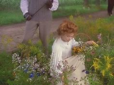 """Anne picking wildflowers while telling Gilbert about her """"rollings reliable"""" story :)"""