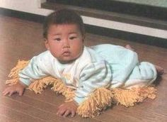 """Feel like your infant isn't pulling their weight around the house? You might want to take a look at """"baby mop"""", the fun little invention that makes sure your baby is actually doing something useful when they're crawling around the kitchen floor."""