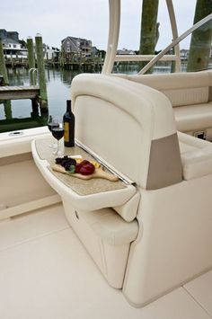 Grady-White Freedom 335: A flip-down table adds to the entertaining capability of the cockpit deck. It does, however, negate the use of the seat below.