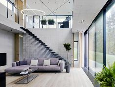 Contemporary concrete residence located in Latvia, designed by Schüco Sverige.